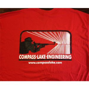 Red compass Lake Engineering t-shirt image of person holding rifle